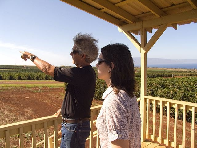 Christina and MauiGrown farm owner Kimo Falconer overlooking the orchard. Photo courtesy of Zachary Ethier.